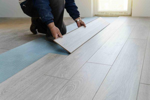 Worker carpenter doing laminate floor work